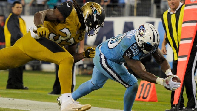 Titans running back DeMarco Murray (29) reaches for a touchdown in the second half as Jaguars strong safety Johnathan Cyprien (37) can't stop him at Nissan Stadium Thursday, Oct. 27, 2016, in Nashville, Tenn.