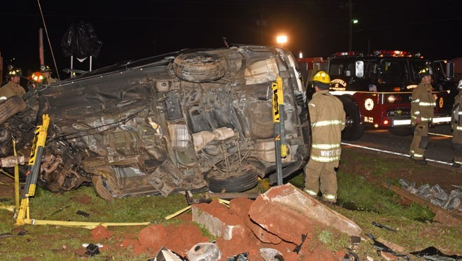 Firefighters respond to a fatal wreck near the Jockey Lot on U.S. 29 early Friday morning.