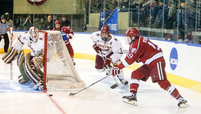 Harvard Crimson forward Jimmy Vesey (19) shoots on Boston College Eagles goalie Thatcher Demko (30) as Boston College Eagles defenseman Ian McCoshen (3) defends during 2016 NCAA Northeast Regional. The big winger had 80 goals in his college career and Buffalo sees a pairing with star center Jack Eichel.