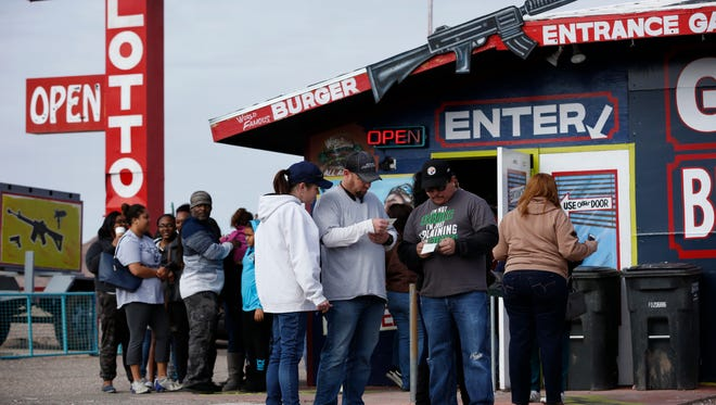 Customers wait in line at The Last Stop in White Hills, Ariz, to buy Powerball lottery tickets on Sunday. White Hill is situated near the borders of Nevada and Utah, two of the few states that don't participate in Powerball.