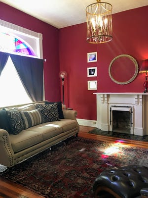 The living room in Dana McMahan's home features one of the eight fireplaces in the 1890 residence.