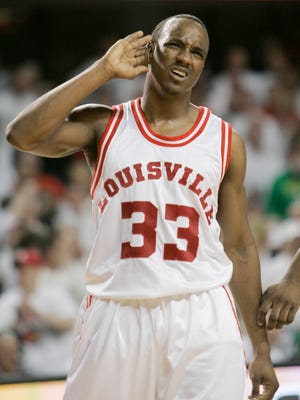 Louisville's Andre McGee pretends to have trouble hearing the cheers of fans after scoring during the second half of their NCAA college basketball game against Marquette in Louisville, Ky., Sunday, March 1, 2009.  McGee led his team with 16 points in the 62-58 Louisville win.