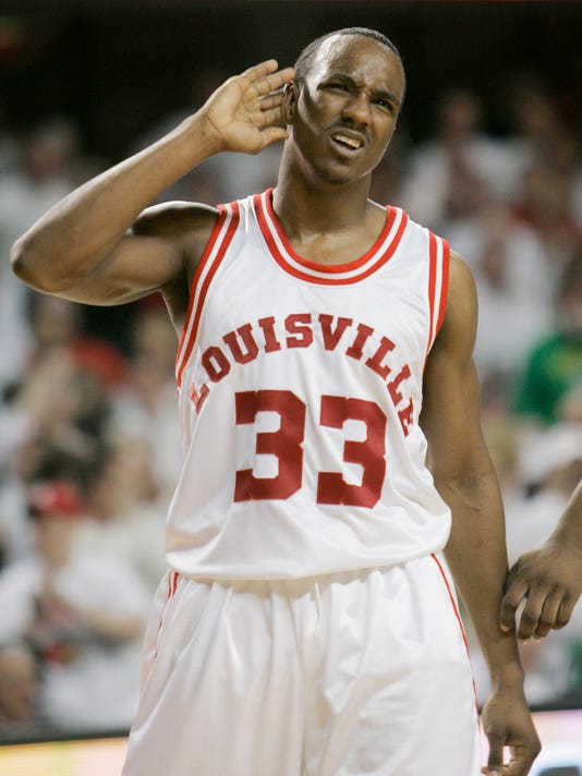 "FILE - In this March 1, 2009, file photo, then-Louisville's Andre McGee pretends to have trouble hearing the cheers of fans after scoring during the second half of their NCAA college basketball game against Marquette in Louisville, Ky. Escort Katina Powell says she has no proof that Louisville coach Rick Pitino knew that a former Cardinals staffer hired her and other dancers to strip and have sex with former recruits and players. But Powell said Tuesday, Oct. 20, 2015, on ABC's ""Good Morning America"" that with ""a boatload"" of recruits and dancers, ""loud music, alcohol, security, cameras"" in a campus dormitory and others aware of the shows, ""how could he not know?"" In her first interview since the release of her book earlier this month, ""Breaking Cardinal Rules: Basketball and the Escort Queen,"" Powell says that the coach had to be aware of some of 22 shows she alleges that former staffer Andre McGee paid and took place in the players' Billy Minardi Hall campus dormitory from 2010-14. (AP Photo/Ed Reinke, File)"