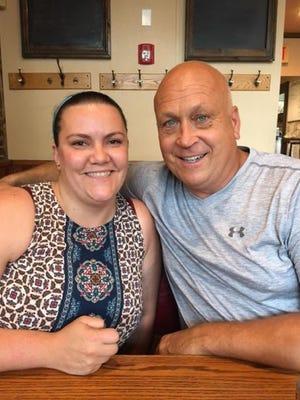 Erin Bergen with Cal Ripken Jr.