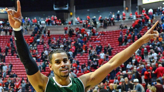 CSU's Gian Clavell celebrates after scoring 37 points, including the winning basket, for the Rams in a 78-77 win at San Diego State. The victory was CSU's first at San Diego State in 14 years and gave the Rams three conference road wins, more than they've had in 11 of the past 16 seasons.