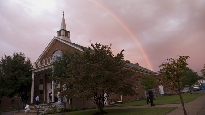 File: A rainbow appears outside the St. Anthony of Padua Church in Camden.