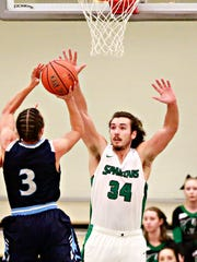 York College's Dalton Myers, right, tries to stop Wesley College's Evan Anderson during men's basketball action in Grumbacher Sport and Fitness Center at York College of Pennsylvania in Spring Garden Township, Wednesday, Jan. 31, 2018. York College would win the game 76-64. Dawn J. Sagert photo
