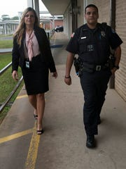Holm Elementary School Principal Kristin Cain, left,
