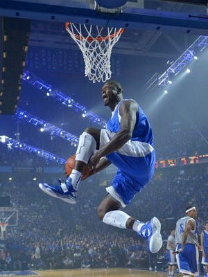 UK's Julius Randle dunks during Big Blue Madness. October 18, 2013