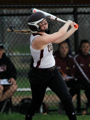 Pittsford Mendon's Courtney Zaucha hits a single against Greece Arcadia.