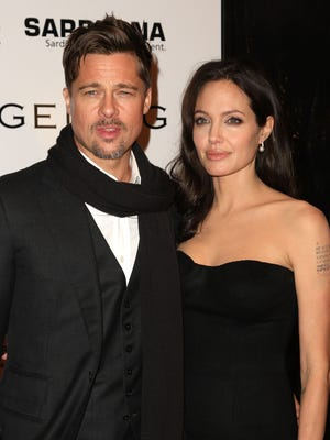 Brad Pitt and Angelina Jolie attend the New York premiere of 'Changeling' in October 2008.