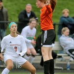 Brighton's Kasey Codd heads the ball away from the goal during Thursday's KLAA championship game at Northville.
