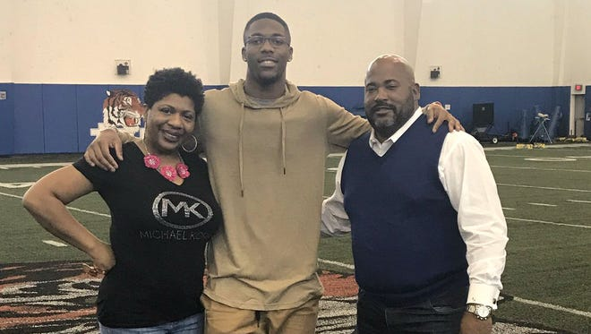 Former Minnesota quarterback Demry Croft, and his mother, with Tennessee State coach Rod Reed at the Tigers indoor practice facility.