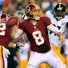 Aug 19, 2013; Landover, MD, USA; Washington Redskins quarterback Rex Grossman (8) throws the ball as Pittsburgh Steelers defensive end Cameron Heyward (97) chases in the third quarter at FedEx Field. The Redskins won 24-13. Mandatory Credit: Geoff Burke-USA TODAY Sports