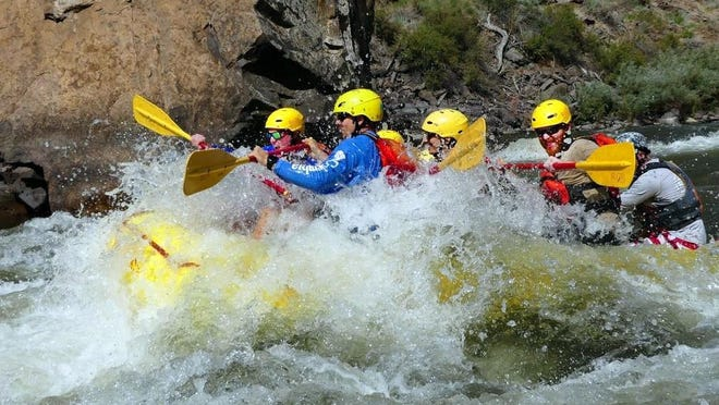 A Royal Gorge Rafting boat floats on the Arkansas River. One guide and one business partner have tested positive for COVID-19 at the Canon City business.