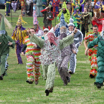 """Courir participants, or """"Mardi Gras"""", run from the"""