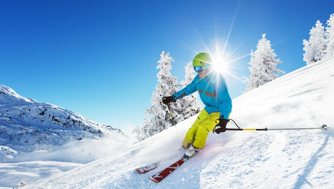 Man skier running downhill on sunny Alps slope