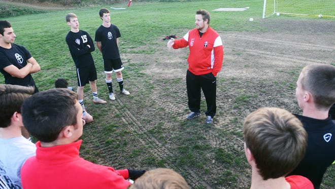 Former Rosecrans coach Rod Gibson talks to his team during a practice in 2015. Gibson, who led the Bishops to back-to-back state tournaments, has been named the ROSA/Arsenal Director of Coaching.