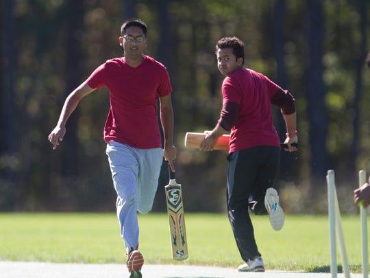Roselle Park batsmen Jay Patel and Parth Shah run during the 2014 UnitedHealthCare NJSBCL Championships Division II Finals on Oct. 5.