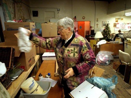 Sister Lorraine Biebel looks through donated goods