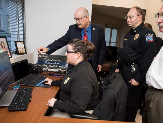 MTSU Police Lt. Kim Rednour, seated, explains the features