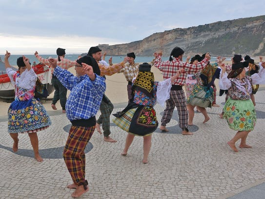 Jovial folk bands in festive costumes bring life to