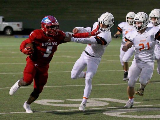 Hirschi running back Daimarqua Foster stiff arms Burkburnett's