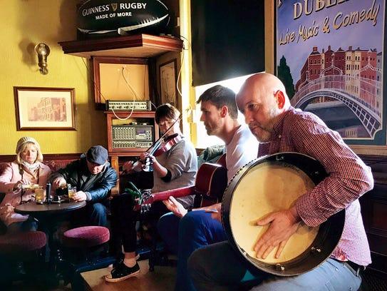 Dublin musicians perform during a musical pub crawl