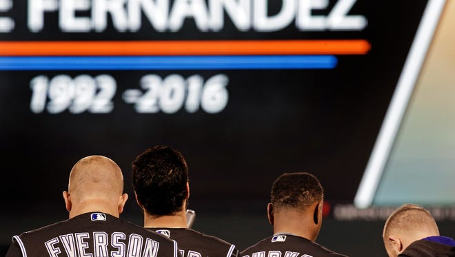 Colorado Rockies including Darin Everson, left, observe a moment of silence for Miami Marlins' pitcher Jose Fernandez prior to a baseball game against the San Francisco Giants, Tuesday, Sept. 27, 2016, in San Francisco. Fernandez was killed in a boating accident on Sunday, Sept. 25, 2016.