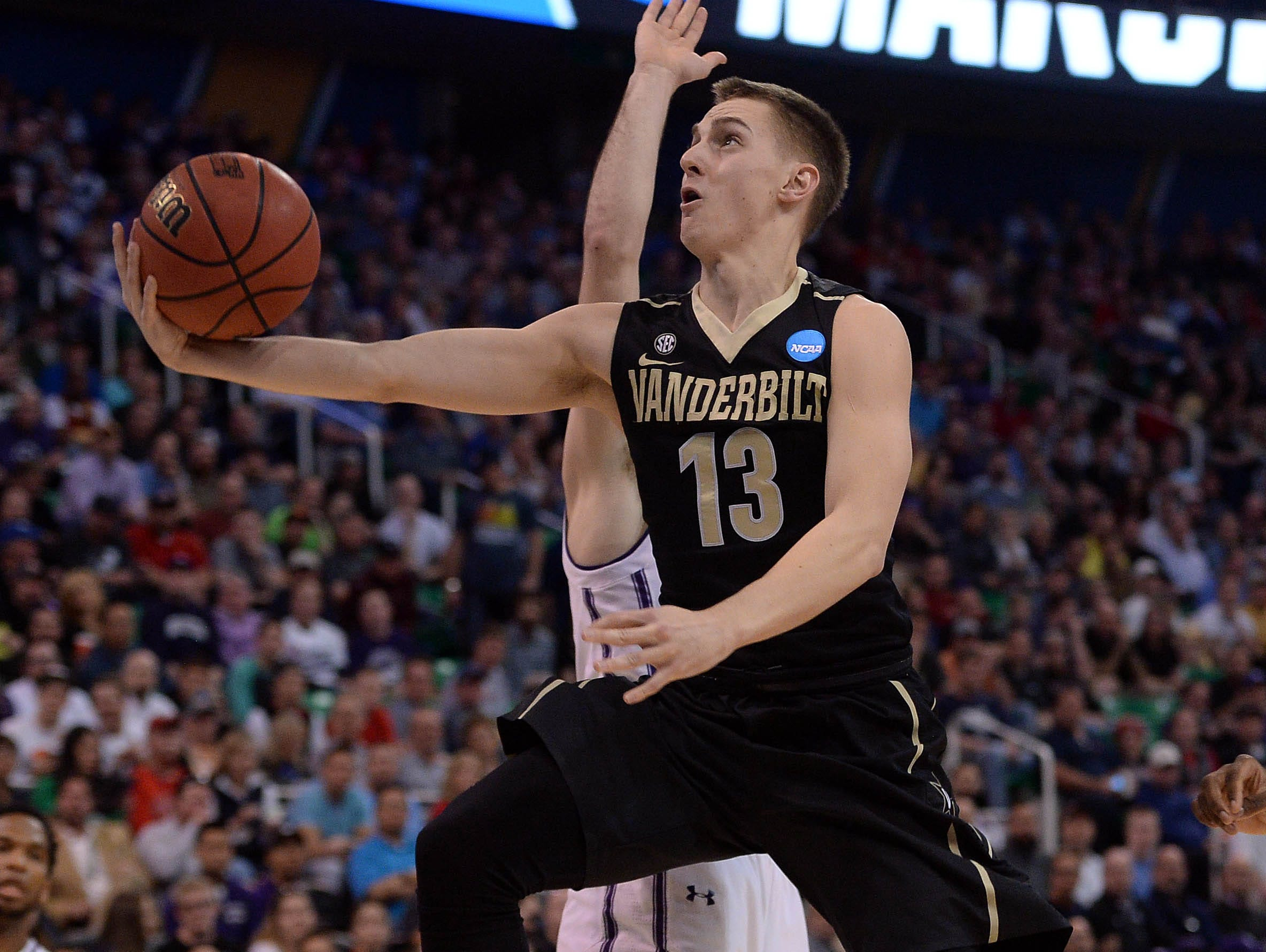 Vanderbilt guard Riley LaChance (13) moves to the basket against Northwestern during the first half of the NCAA Tournament first-round game in Salt Lake City on March 16, 2017.