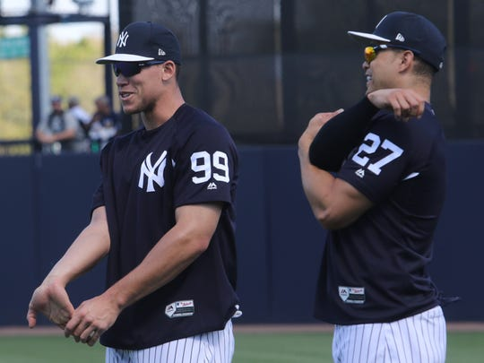 Aaron Judge and Giancarlo Stanton side by side during stretches.