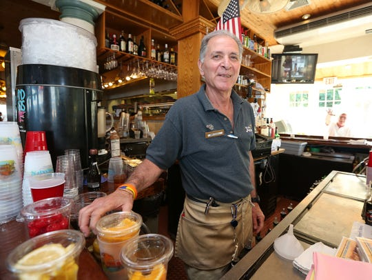 Michael Sottile tends the bar at Seaside Johnnies in