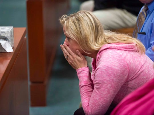 Meridith Berry, Melissa Jenkins' cousin, reacts in Vermont Superior Court in Burlington on Wednesday, October 22, 2014 as they jury finds Allen Prue guilty of first-degree murder and two other charges in the 2012 slaying of Jenkins.