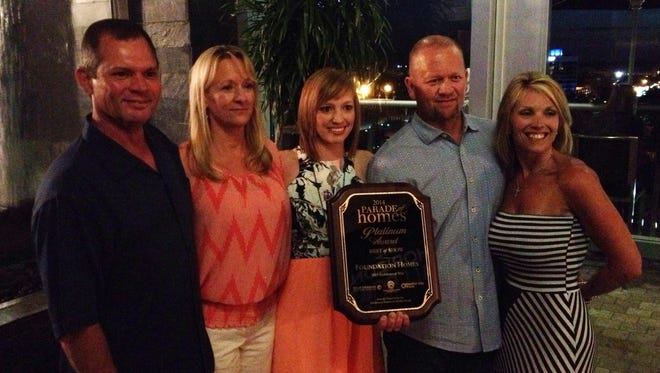 Foundation Homes won Best of Show in the 2014 Parade of Homes. Pictured here are Steve Byrd, Jackie Byrd, Amy Odeneal, Gil Chason and Sandi Chason.