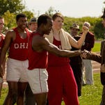 """Stephan James (center) is Jesse Owens and Jason Sudeikis (right) plays his coach, Larry Snyder, in the new movie """"Race,"""" centered on Owens' triumphs and trials on the road to the 1936 Olympic Games in Berlin."""