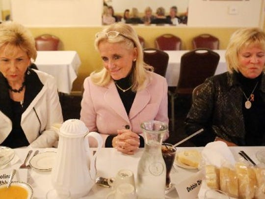 Congressional candidate Debbie Dingell, center, has a lunch meeting with a group of women including Karen Colina Wilson Smithbauer, left , a cancer survivor and Becky Kaplar, right, on Oct. 21, 2014 in Southgate. The lunch was to chat about breast cancer and the needs for women and men in regard to this disease.