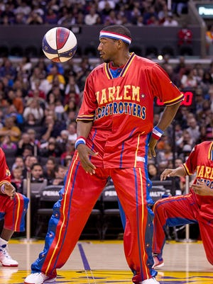 """The """"Magic Circle"""" is a Harlem Globetrotters tradition that gets players like Buckets Blakes in tune with his teammates and shows off some of their ballhandling skills."""
