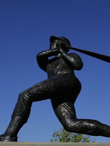 A statue of Hank Aaron stands outside of Turner Field.