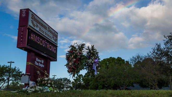 A rainbow appears over Marjory Stoneman Douglas High School on Monday, Feb. 26, 2018.