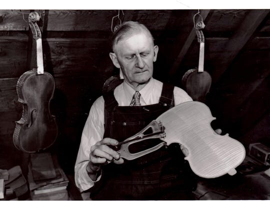 Sheboygan violin maker Alfred Ferdinand Smith works on a violin in this undated photo.