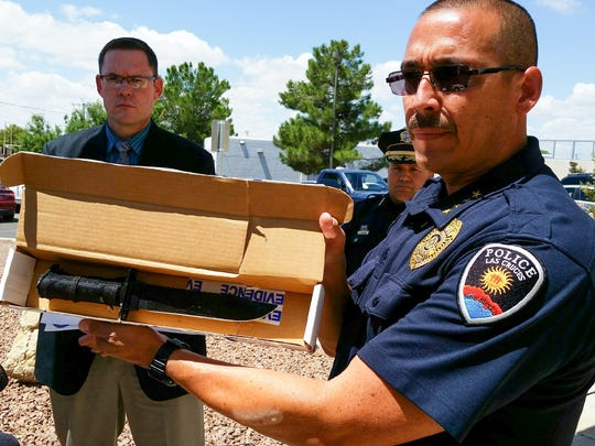 During a news conference, Las Cruces Police Chief Jaime Montoya displays a 14-inch hunting knife that Juan Gabriel Torres was carrying when he lunged at officers on Aug. 21, 2016.