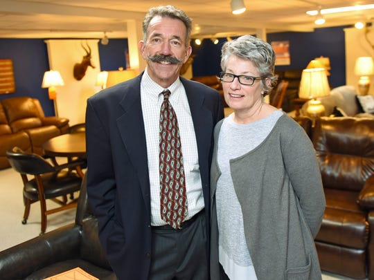 Harry Morningstar and his wife, Jill, pose in Schier's Furniture Market, Waynesboro, on Wednesday, January 25, 2017.  The owners are retiring from the business they've owned for nearly 40 years.