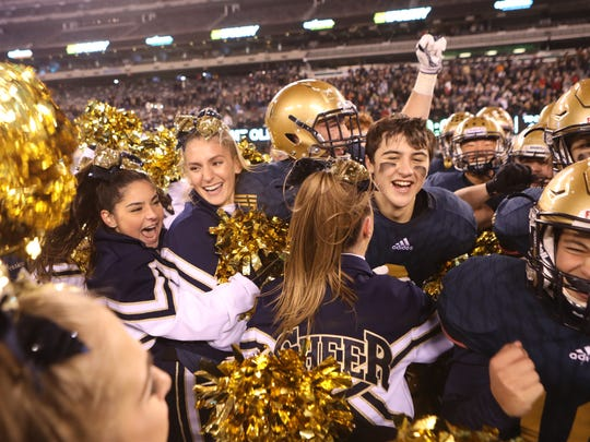NV/Old Tappan cheerleaders and football players celebrate their 31-28  victory over Mt. Olive for the NJSIAA North I Group IV Football Championship in East Rutherford, Sunday, December 2, 2017.