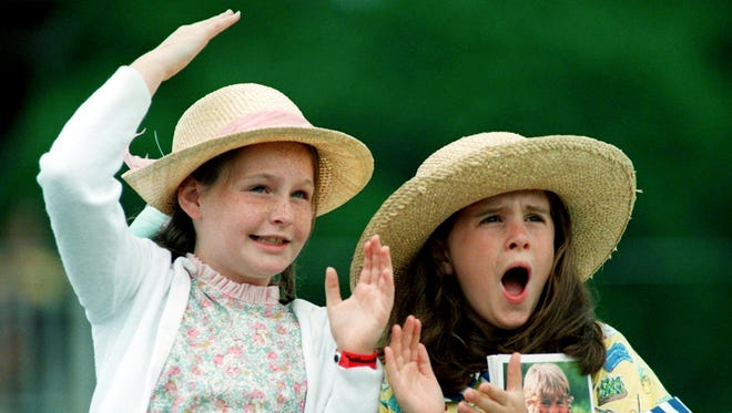 This file photo shows Alice Campbell, left, and Jennie McCade, both 9, cheering on their favorite horses during the running of the 55th annual Iroquois Steeplechase on May 11, 1996.
