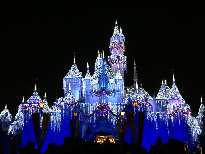 Disneyland's Sleeping Beauty Castle lit up on a winter night.
