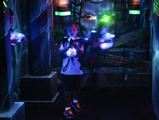 Kids play laser tag at Laser Oasis in La Quinta, April