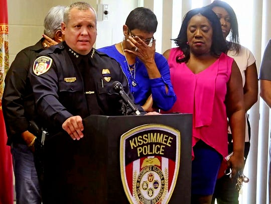 Kissimmee Police Chief Jeff O'Dell, left, holds a news