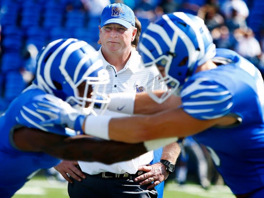 Memphis defensive coordinator Chris Ball watches warmups before taking on UCLA on Sept. 16, 2017, at Liberty Bowl Memorial Stadium.