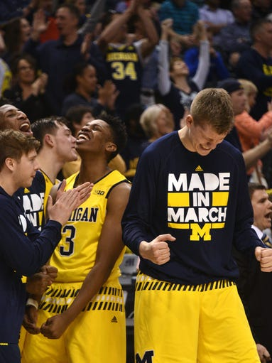 The Michigan bench, including Kameron Chatman (3) and