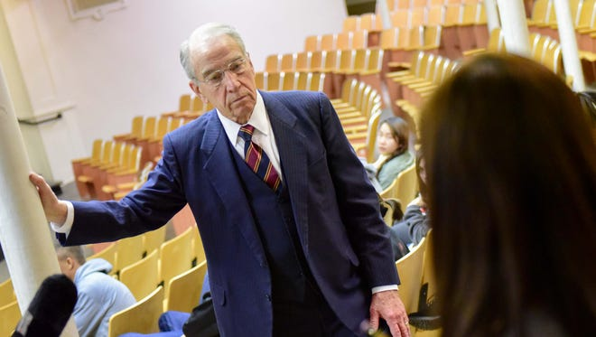 U.S. Senator Chuck Grassley answers a question from East Senior Nisham Subba on Monday, November 23, 2015, during a visit to East High School.